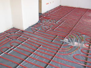underfloor heating pipes being installed